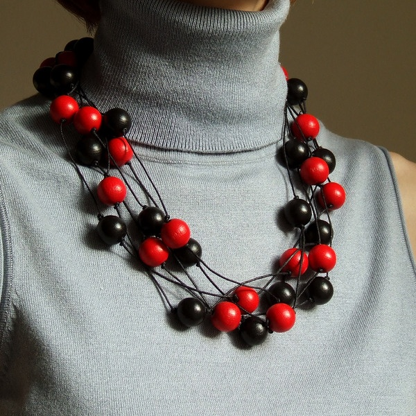 Necklace. Handmade with wooden big round black and red beads.  Perfect to knitwear.