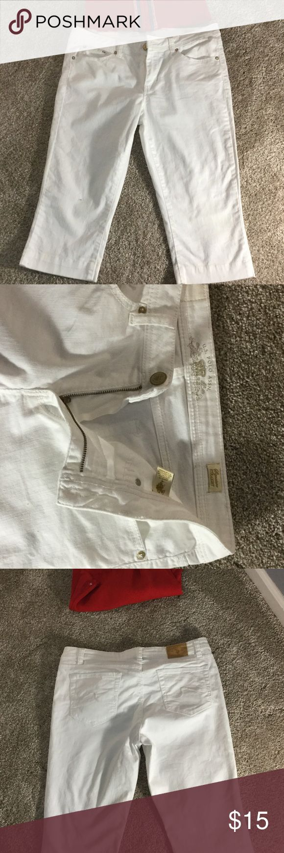 Size 8 US Polo white capris Adorable Size 8 US polo capris.  Can wear long or cuff them. Worn cuffed 14 inches long and un cuffed 17 inches long.  Mid rise so very flattering. US Polo Pants Capris
