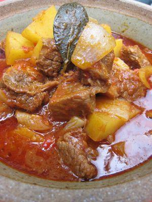 beef mechado - beef slowly braised in tomato sauce, onion and bay leaves    http://www.marketmanila.com/archives/beef-mechado-a-la-marketman