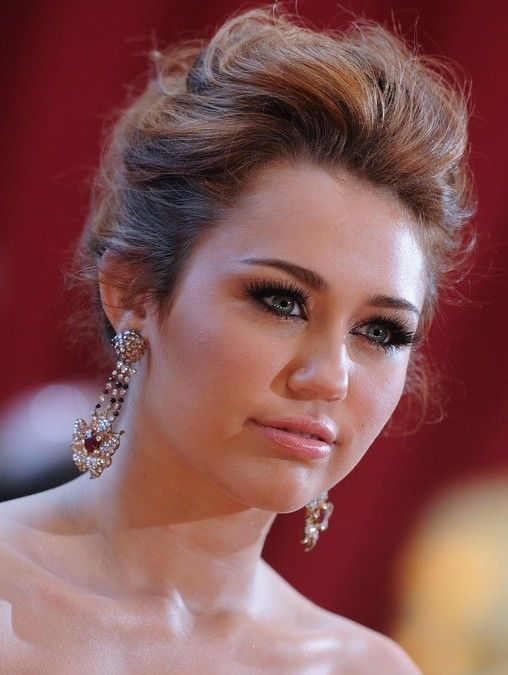 Miley Cyrus Loose Messy Bun Updo: Romantic Updos for Wedding