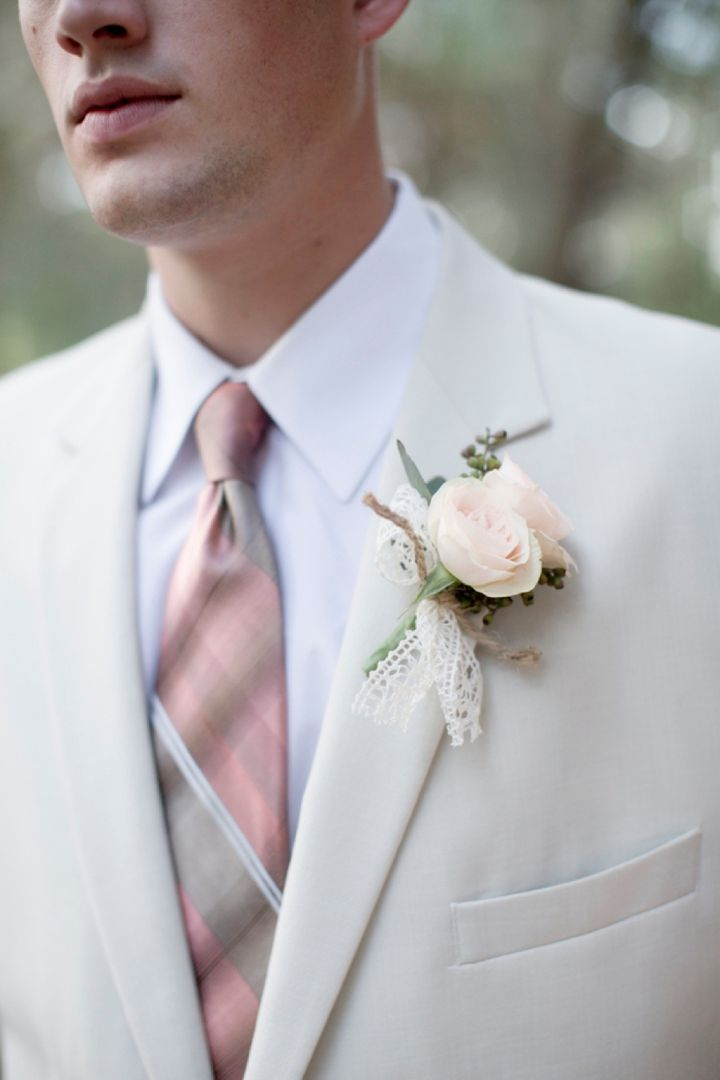 Pale pink boutonniere with lace and twine accent