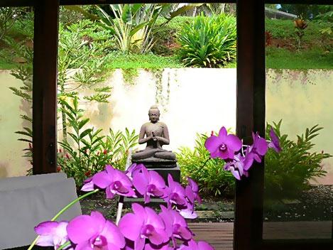 Hale O Ani Guest House, Kauai - life size stone carved Buddha in courtyard