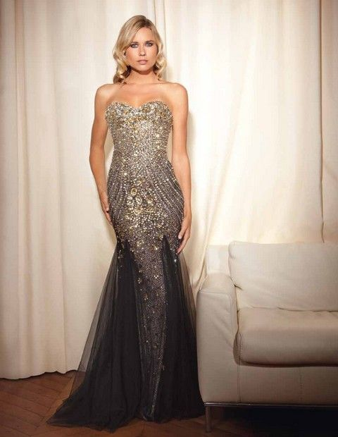 Luxusné spoločenské šaty korzetové, bohato vyšívané korálkami a kameňmi vhodné ako šaty na ples, prípadne na iné slávnostné príležitosti.