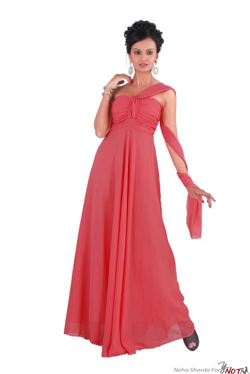 Pink Georgette Tube Gown With Panel By : Neha Kamal Sharda Description  This is a stunning pink georgette tube gown that comes with panel at bust and the beauty is enhanced by the panel to drape around neck or arms.