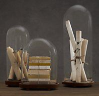 Restoration Hardware's 1920s French Glass Cloche Collection:A French invention, glass domes have been used for centuries to protect and display cherished objects, from rare orchids to antique pocket watches to objets of curiosity. Ours are made of clear glass in three sizes and set on footed wooden stands.