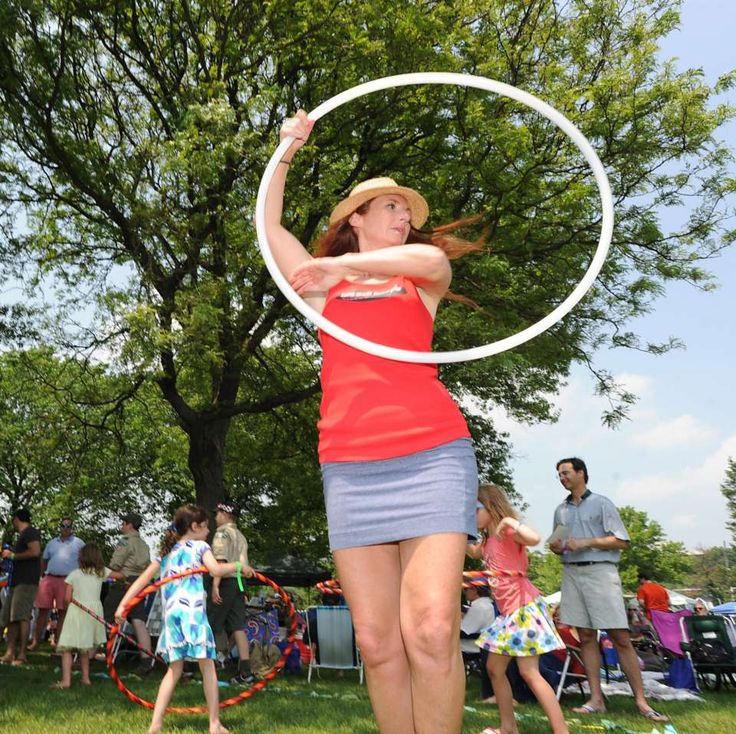 Mary-Beth Oliver of Milford performs with her hoop during the Greenwich Town Party at Roger Sherman Baldwin Park, Saturday, May 26, 2012.