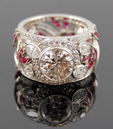 Platinum, Diamond and Ruby Ring wish i could afford a couple dozen of theses. I wouldn't buy a couple dozen just wish i could...lol