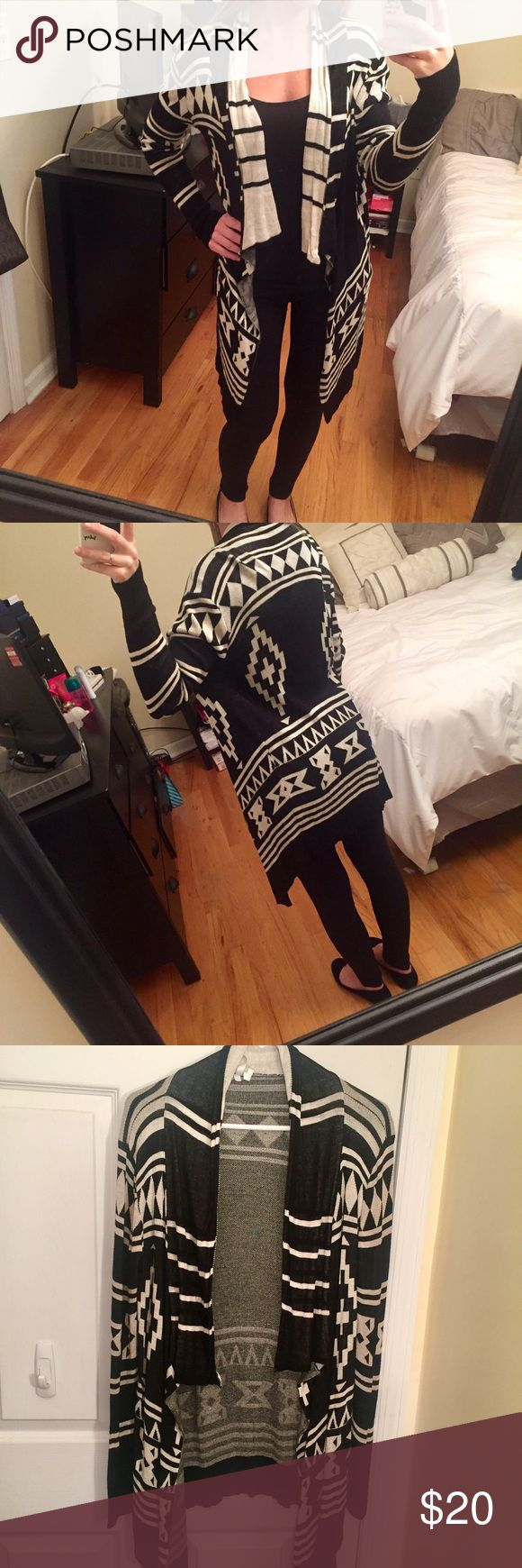 Black and cream Aztec print cardigan Black and cream colored Aztec printed cardigan that I bought from Garage. Super comfy and cute! Longer in the front than in the back. Has small hanger bumps on both shoulders from being hung dried on a hanger, but can be removed. Other wise no damage in good condition. Size small. 😊 NO TRADES🙅🏻 Garage Sweaters Cardigans