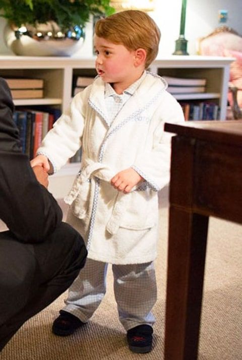 Prince George meeting President Barack Obama in Kensington Palace in his personalized robe, matching pajamas and slippers, April 2016