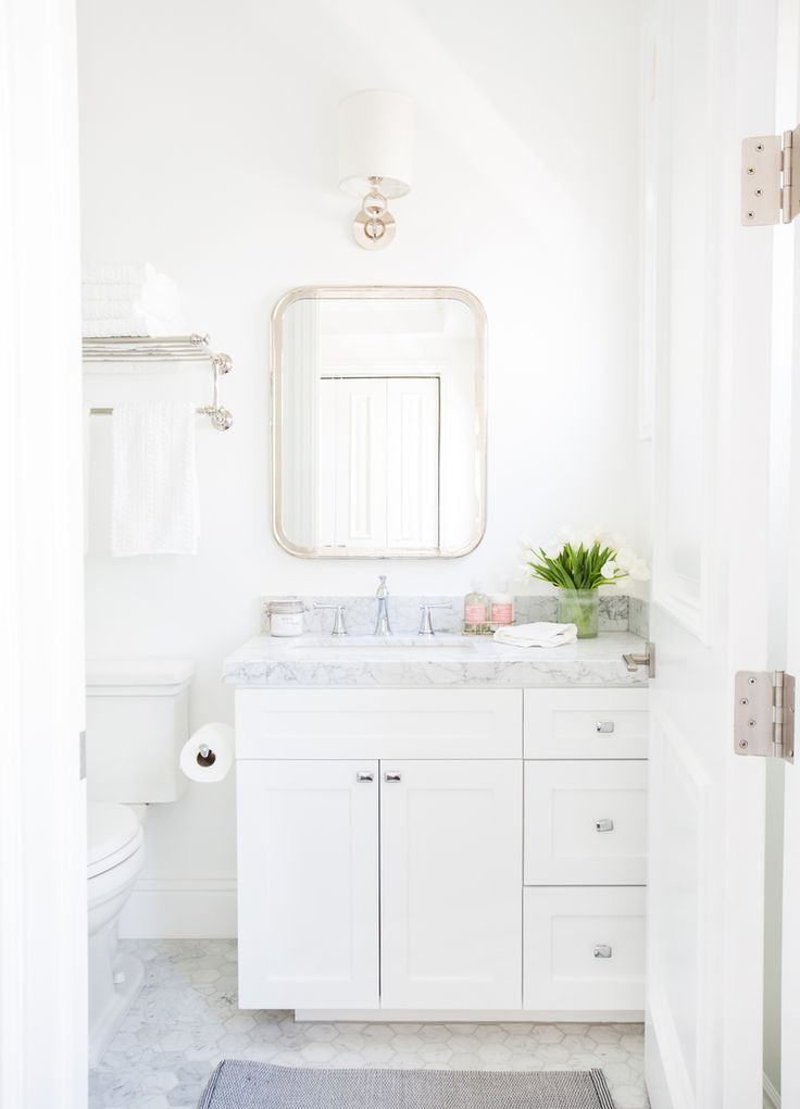 Best Photo Gallery Websites Crisp white bathroom with marble hex tile Studio McGee