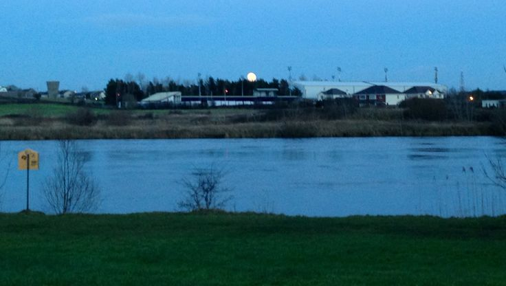 Moon rising across the river corrib