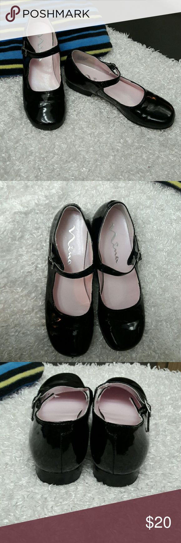 Nina Girls Patient Leather Mary Jane Shoes Brand Nina Size Girls 1Narrow brand tends to run wide Bonnett Black Patient Leather Mary Jane Dressy Shoes. This style defines little girls fashion from decade to decade. Adjustablevstrap buckle.  These are like new but have a tiny flaw at toe tip see Picture more on underneath of toe so not noticeable while wearing unless you look hard.  Clean and otherwise like new worn once.  Bundles available with a 20% discounts Offers Welcome Nina Shoes Dress…