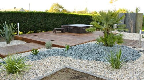 Terrasse en bois exotique avec spa evenement arbor for Paysagiste jardin exotique