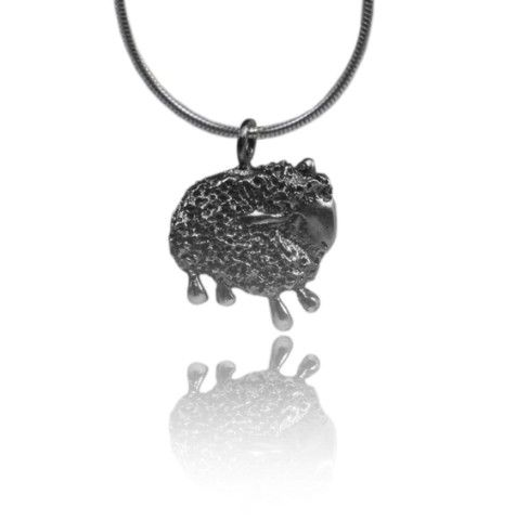 Black and white sheep silver pendant by LiatWaldmanJewelry on Etsy, $80.00