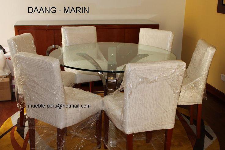Hermoso comedor daang marin con moderna mesa de acero y for Sillas de comedor elegantes