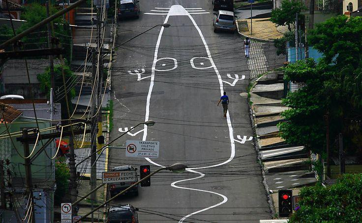 Depois de lagartixa, muralista argentino desenha rato gigante na rua Caiubi, em Perdizes, na zona oeste de SP.
