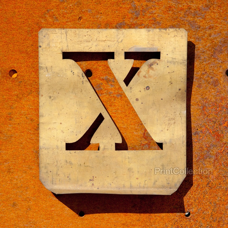 """This letter """"X"""" is but one of a very large collection of metal type stencils for labeling business packaging. Dates back to the 1940?s. Photographed here on a beautifully rusted steel sheet."""