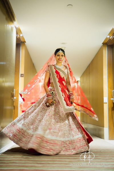 white and red lehenga, gold embroidery, red dupatta, twirling bride, twirling lehenga