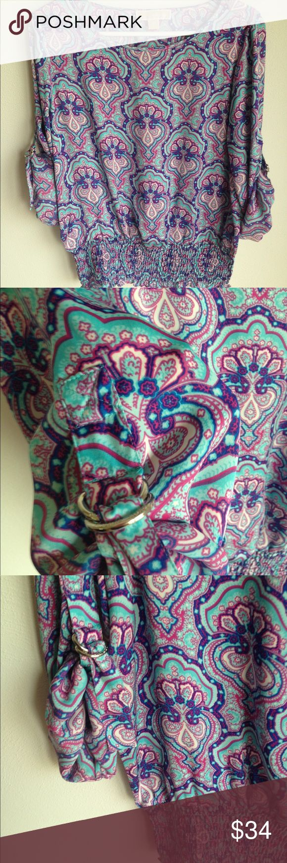 """Michael Kors paisley printed long sleeve blouse Michael Kors paisley printed blouse with smocked waist and adjustable silver buckles on sleeves. Measures approximately 42"""" bust, 30"""" waistband (stretches), and 24"""" long. MICHAEL Michael Kors Tops Blouses"""