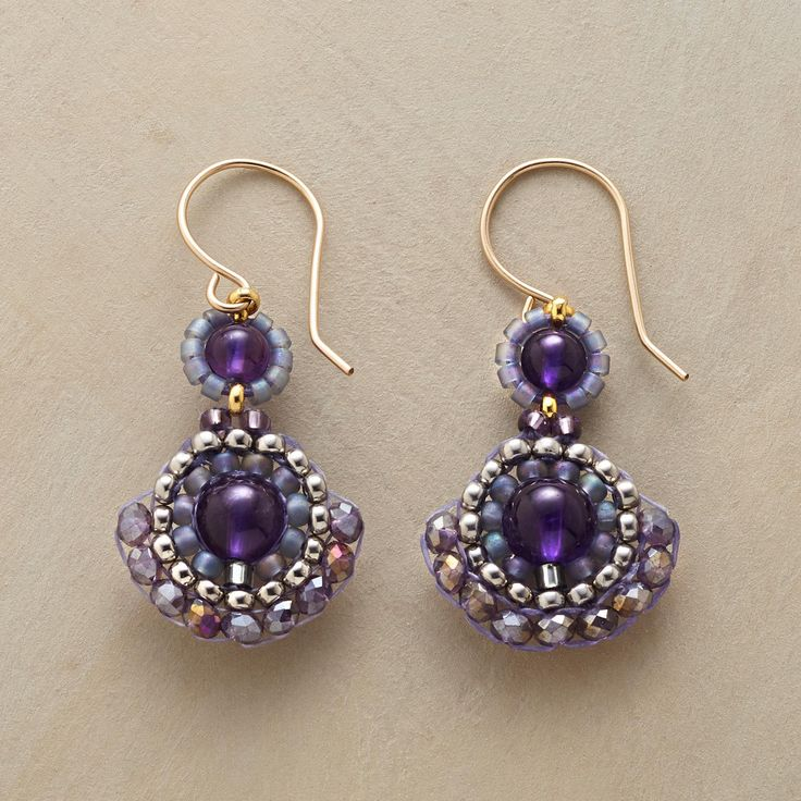 "SPANISH FAN EARRING -- Amethyst, quartz and Japanese Miyuki beads fan out in hand-beaded earrings designed by Miguel Ases. 14kt goldfilled wires. USA. 1-1/2""L."