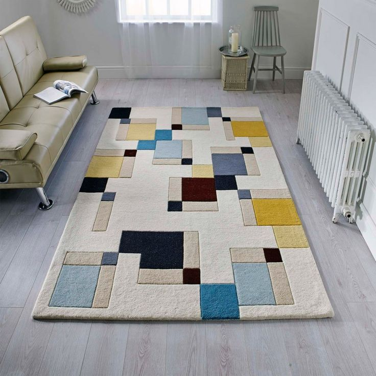 Illusion Abstract Blocks Blue/Ochre Wool Rug is a combination of different colour-blocked boxes, which zings up your interior and creates a new ambience. So, bring home the new vibrancy for your decor. #FlairRugs #TheRugShop #ComfyRugs #CostEffective.