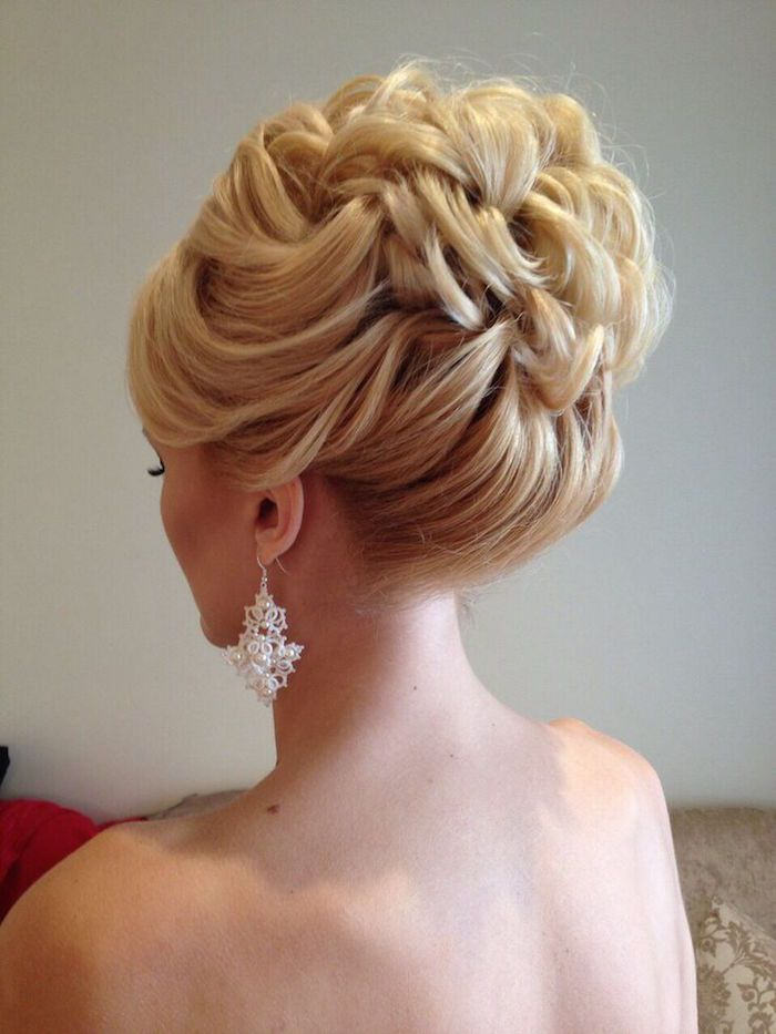 Gorgeous wavy hair pulled up into a braided wedding hairstyle. via Elstile