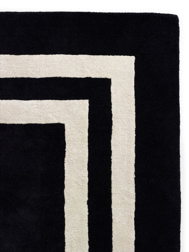 our home décor motto: buy what you love and you'll never go wrong. like this double border rug--it's a classic, elegant and a gorgeous base for a so-you room.