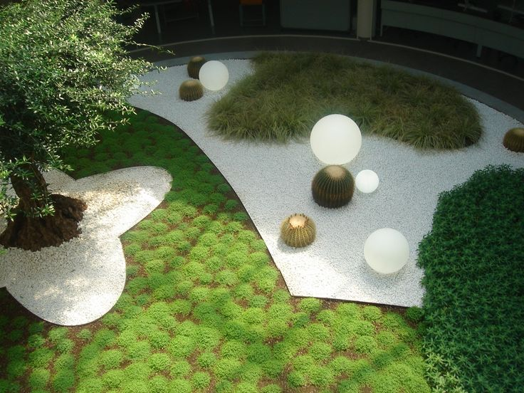 Piedmont. Corporate garden in Valenza. A green diamond in the core of Recarlo Maison.