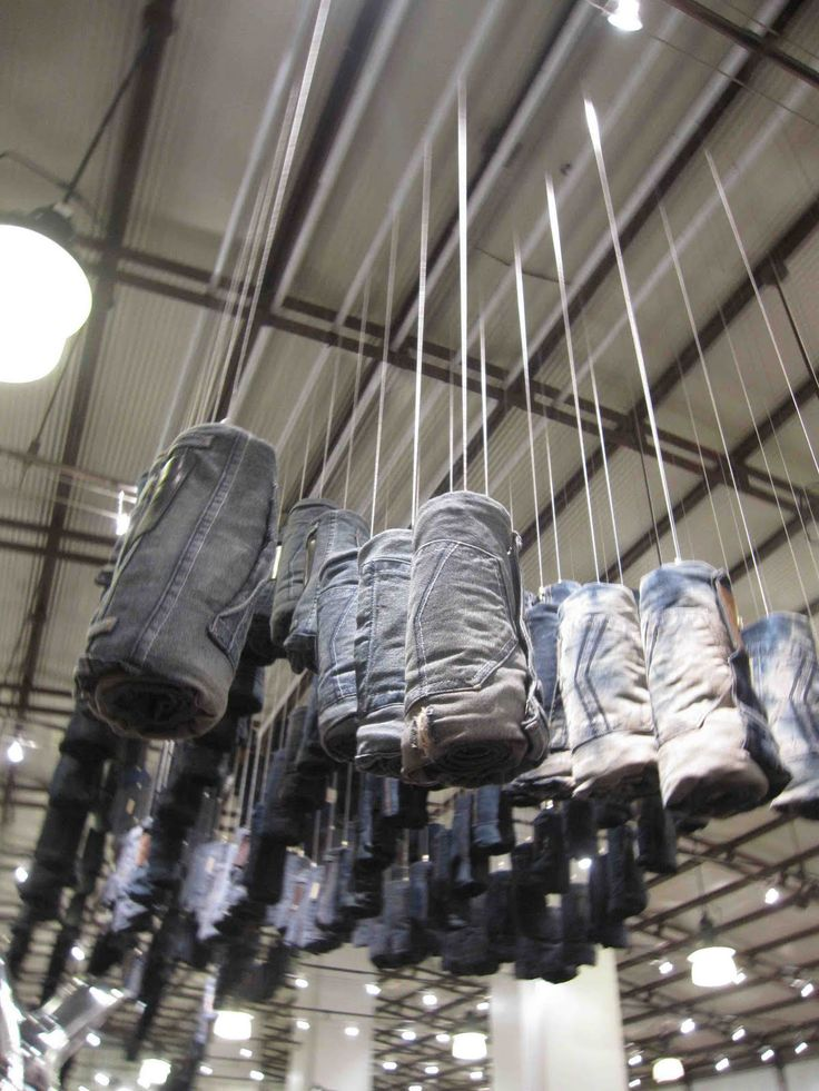 This image shows how they display denims in the store. The denims are hanging from the ceiling.
