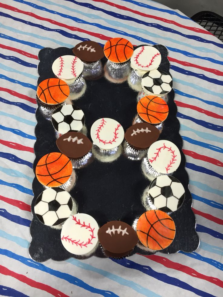 Sports birthday cupcake number baseball football basketball soccer. Done on fondant with edible markers