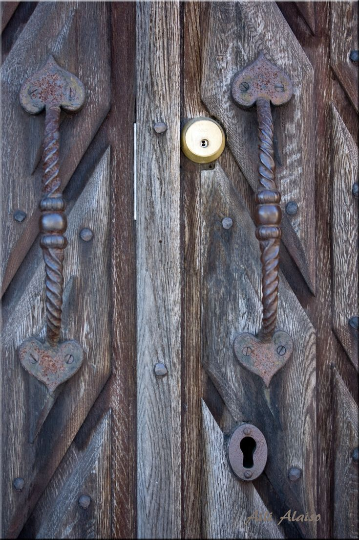 A very old door at the Suomenlinna wall. The construction of Suomenlinna began in 1748 . Helsinki Finland by Aili Alaiso