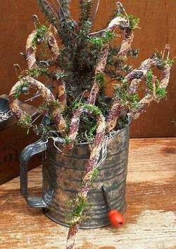 Grungy Rag Candy Canes & Pine...stuffed in an old flour sifter.