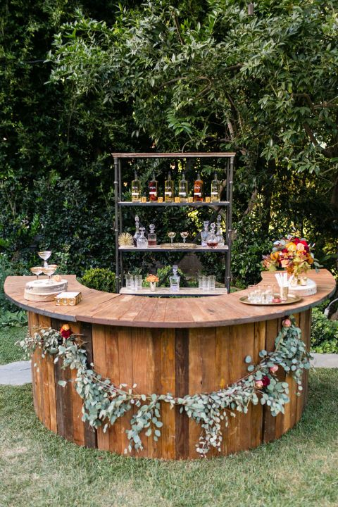 Reclaimed wood is a country staple, and this rustic bar from Archive Rentals proves it can be elevated from trash heap to style star. A garland by Chloe + Mint adds a country chic touch. Photo credit: Jessica Lynne Studios; Planner: EDE By Jacqueline