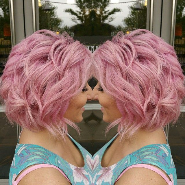 Curly pink hair color and bob hairstyle. Hair artist Taylor Rae. hotonbeauty.com