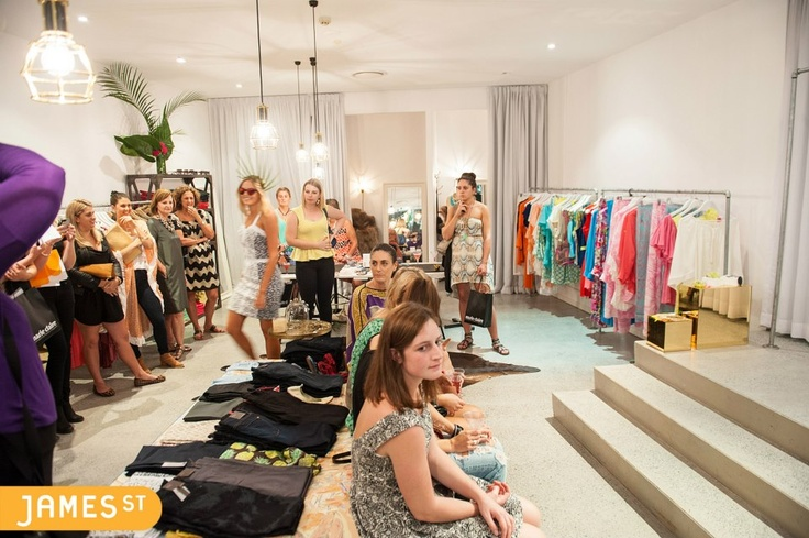 Shoppers eagerly await the fashion show at Alexis Dawn