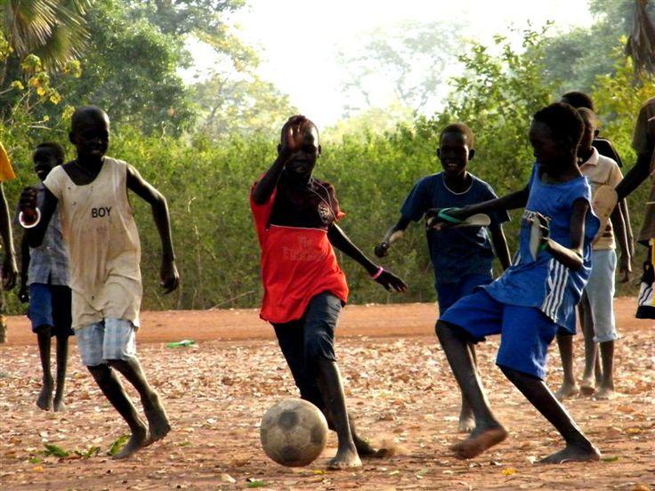 Sudanese boys playing football.