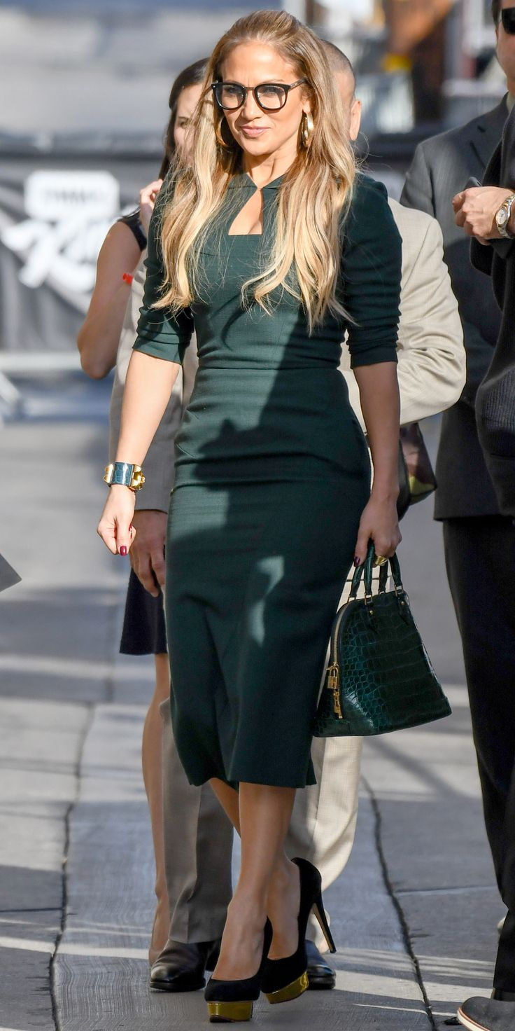 Jennifer Lopez proved that $30 reading glasses by Privé Revaux can actually be quite sexy with the help of a fitted green dress, sky-high heels, and gold hoop earrings.