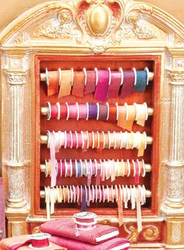 Silk Shop by Polly Morris, Ribbon Display. I used dupioni silk to make the ribbons in this ribbon rack. I mounted the fabric to manilla folders with tacky glue to avoid raveled edges when the ribbons were cut. This photo does not do justice to the lovely way these ribbons appear to shimmer and change colors in real life.