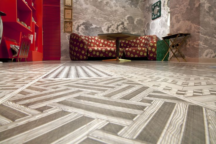 XILO1934 decorated wood floor in Fornasetti's Milano shop renovation. October 2014. Design: Piero & Barnaba Fornasetti