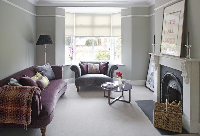 The living room in this 1940s house is a celebration of luxurious finishes. The velvet sofas and plush carpet are complemented by silky cushions for a wonderful feelgood factor.    - housebeautiful.co.uk