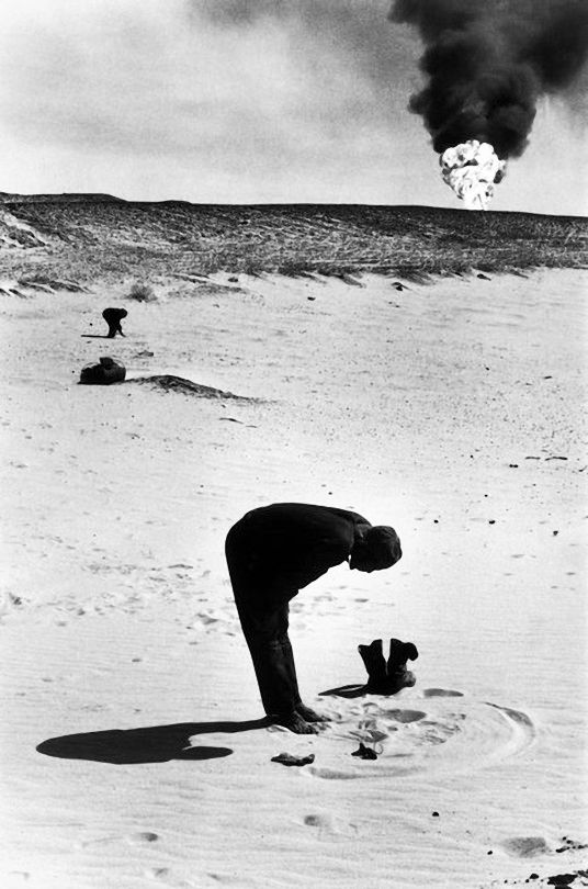 moslem praying towards mecca at rub al khali in the deserts of saudi arabia, 1974[original] © marc riboud/ magnum photos