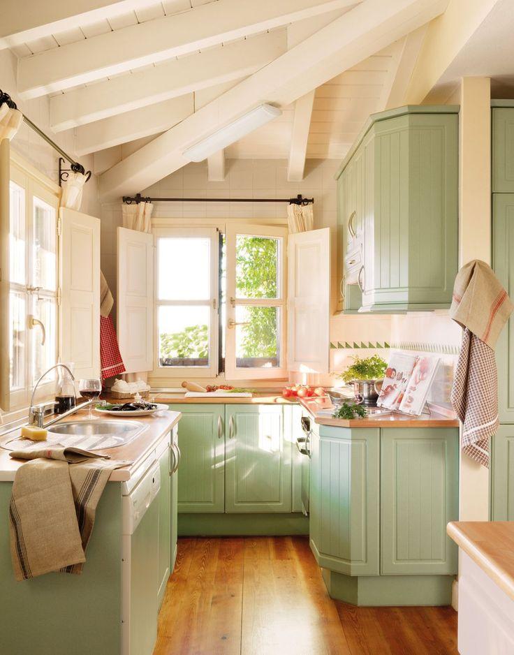 Cottage kitchen. Love the cabinet color.