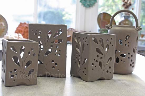I'm looking for some ideas to do in my Pottery class. I own a million candles/tealights so thought I might make a set of three lanterns to place on centre of dining table. Love the pattern on this :)