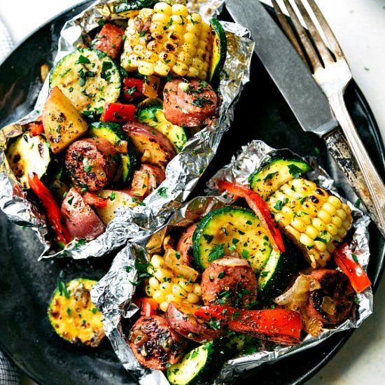 The EASIEST dinner -- tin foil sausage and veggie packets on the grill or in the oven! Delicious seasoning mix!