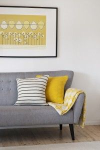 Adding yellow brightens up this living space and ties the room together