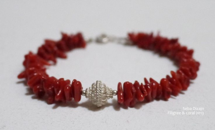 This delightful bracelet will add a splash of colour to any out fit. It features a sweet handmade silver bead with a diameter of 10mm and natural Adriatic Coral. Sterling silver spacers have been added on either side of the filigree bead and at each side of the silver clasp. Bracelet length 18cm. Price: €75.00