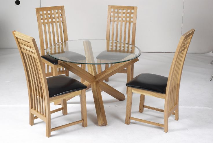 """Oporto Table  42"""" round table with solid Oak legs.  Overall height: 740mm Shown with Mirelle Chair"""