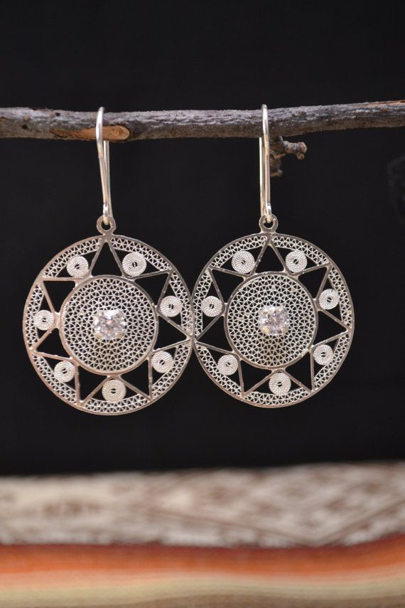 Silver leaf jewelry co: Round Earrings
