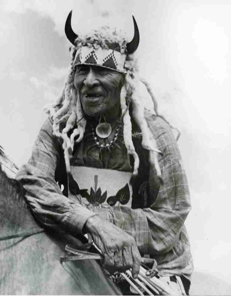 A close up portrait of Fine Day on horseback. Fine Day was Poundmaker's Chief Warrior at the Battle of Cut Knife Hill during the Riel Rebellion of 1885. He is shown wearing an elaborate headpiece mounted with buffalo horns and trimmed with weasel skins. Fine Day died on January 8, 1942 at the age of 94.