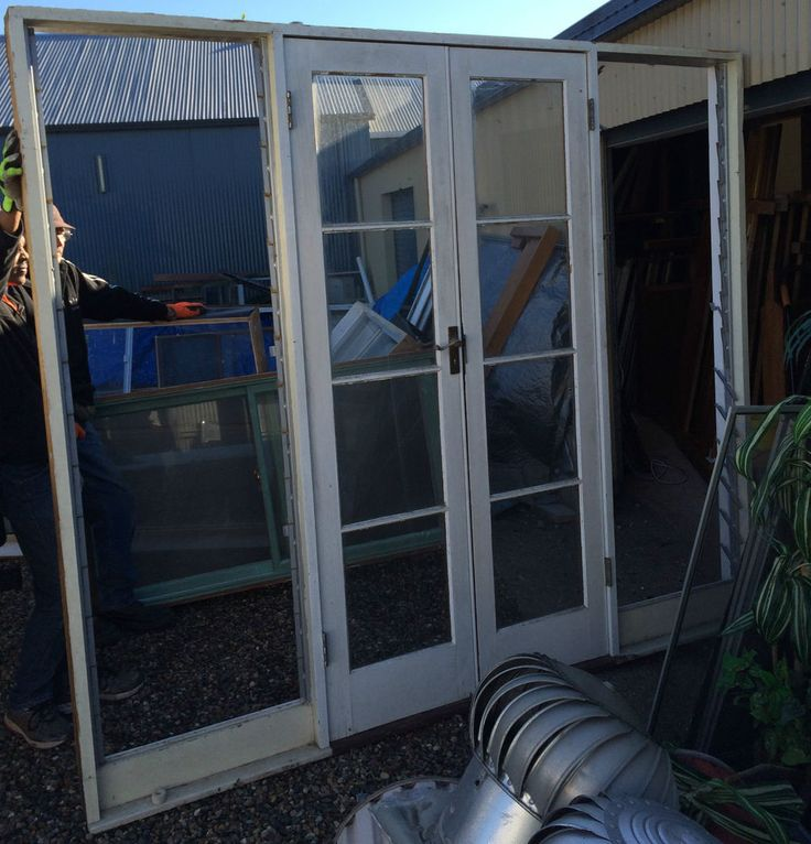FRENCH DOORS IN FRAME WITH LUVERS EACH SIDE
